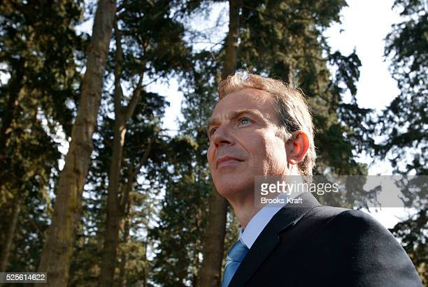British Prime Minister Tony Blair watches President Bush's helicopter depart Hillsborough Castle after the leaders held their third meeting in three...