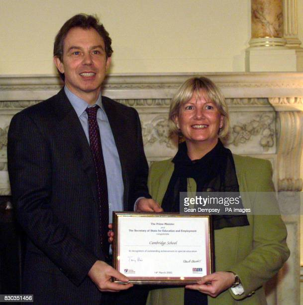 British Prime Minister Tony Blair with Julie Barton of Cambridge School in London at Downing Street in London The Prime Minister attended a reception...