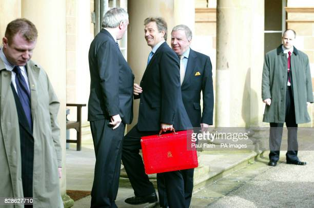 British Prime Minister Tony Blair with Taoiseach Bertie Ahern and Secretary of State Paul Murphy arriving at Hillsborough Castle County Down where Mr...
