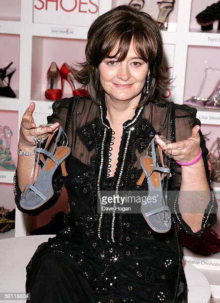 British Prime Minister Tony Blair's wife Cherie Blair displays a pair of her donated shoes at the aftershow party following the UK Premiere of In Her...