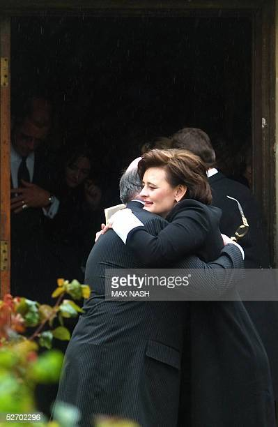 British Prime minister Tony Blair's wife hugs an unidentified man after the funeral service for Sir John Mills at St Mary The Virgin church in Denham...