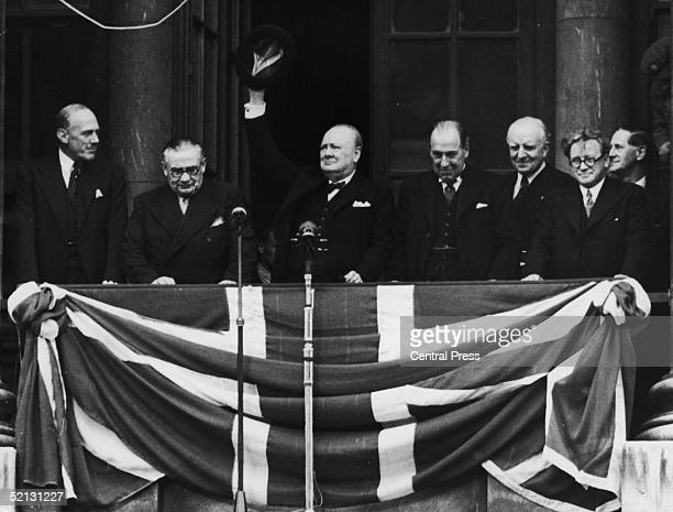 British Prime Minister Winston Churchill addresses the crowds from the balcony of the Ministry of Health in Whitehall on VE Day 8th May 1945 From...