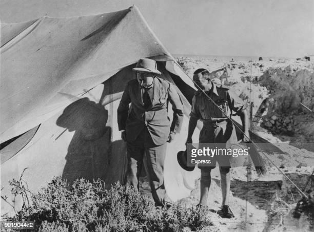 British Prime Minister Winston Churchill and Australian officer Leslie Morshead enter Morshead's tent near Alamein in Egypt during World War II...