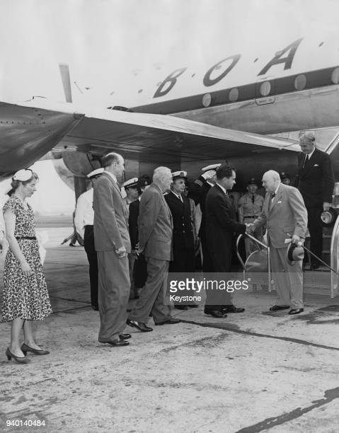 British Prime Minister Winston Churchill and Foreign Secretary Anthony Eden are greeted by US VicePresident Richard Nixon and US Secretary of State...