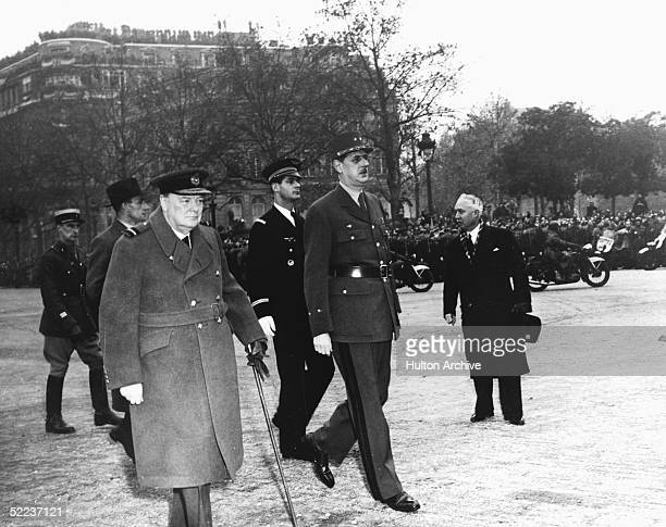 British Prime Minister Winston Churchill and French general Charles de Gaulle walk down the Champs Elysees during Churchill's visit Paris November 11...