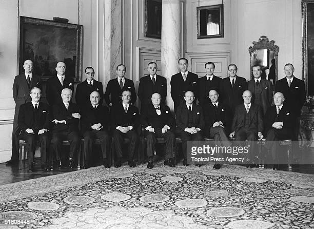 British Prime Minister Winston Churchill and his last cabinet photographed at 10 Downing Street, 5th April 1955. Back row, left to right: Osbert...
