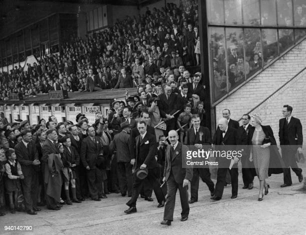 British Prime Minister Winston Churchill and his wife Clementine arrive at Walthamstow Stadium in London for his final election speech 3rd July 1945