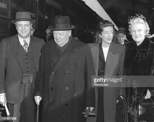 British Prime Minister Winston Churchill and his wife Clementine Churchill Baroness SpencerChurchill along with two of their children politician...