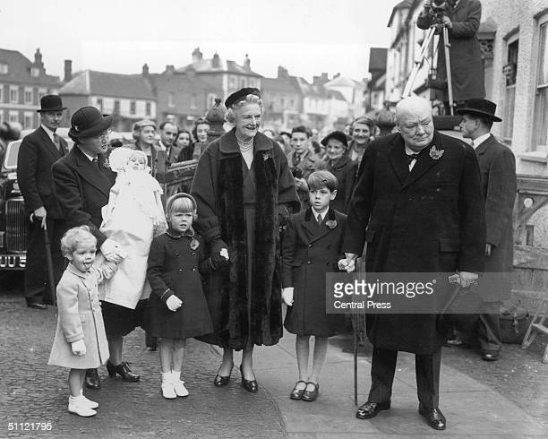 British prime minister Winston Churchill and his wife Clementine attend the christening of their grandchild Charlotte at Westerham Parish Church 6th...
