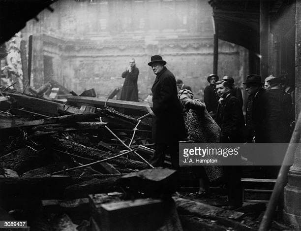 British Prime Minister Winston Churchill and his wife inspect bomb-damage in the City of London during the Blitz, 31st December 1940.