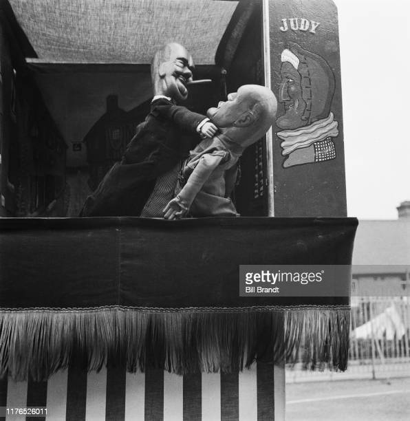 British Prime Minister Winston Churchill and Italian dictator Benito Mussolini in puppeteer Tom Haffenden's topical wartime Punch and Judy puppet...