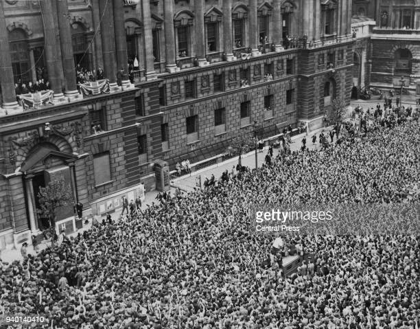 British Prime Minister Winston Churchill and the war cabinet greet the crowds from the balcony of the Home Office in London on VE Day, World War II,...
