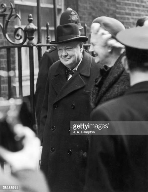 British prime minister Winston Churchill arrives at Downing Street with his wife Clementine after a holiday in Jamaica 29th January 1953