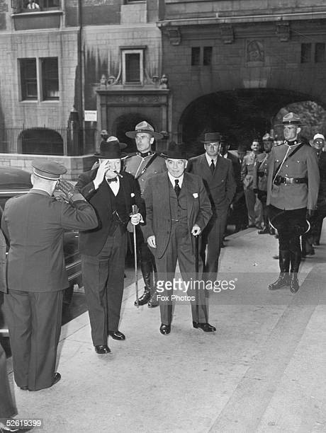British Prime Minister Winston Churchill arrives for the Quebec Conference at the Chateau Frontenac Quebec with Canadian premier William Mackenzie...