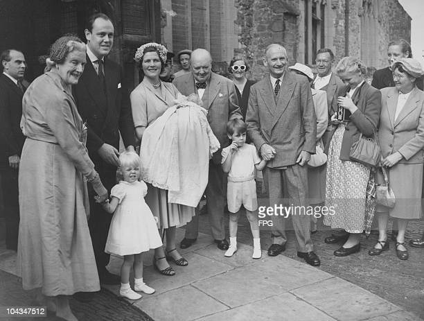 British Prime Minister Winston Churchill attends the christening of his grandson Jeremy Soames at Westerham Paraish Church in Kent 17th August 1952...