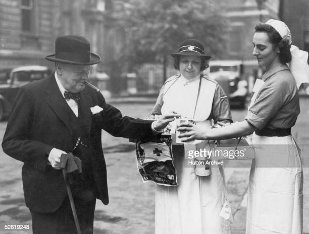 British Prime Minister Winston Churchill buys a flag on Red Cross Flag day 5th June 1941