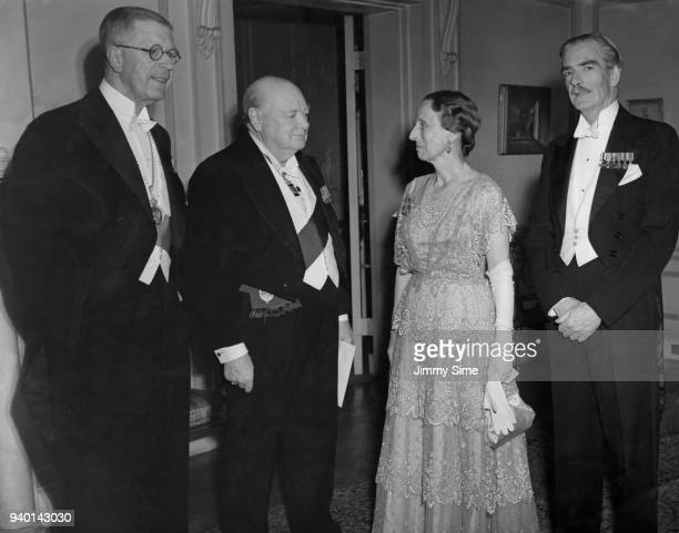 British Prime Minister Winston Churchill dines with King Gustav VI Adolf of Sweden at the Swedish Embassy in London 10th November 1953 From left to...