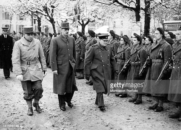 British Prime Minister Winston Churchill French President Charles De Gaulle and French General Jean de Lattre de Tassigny reviewing the troops ready...
