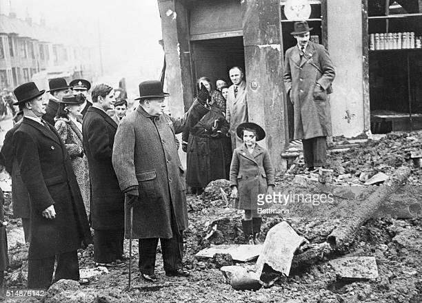 """British Prime Minister Winston Churchill gestures to residents of Bristol, which came under heavy bombing by Germany. """"We shall let them have it..."""
