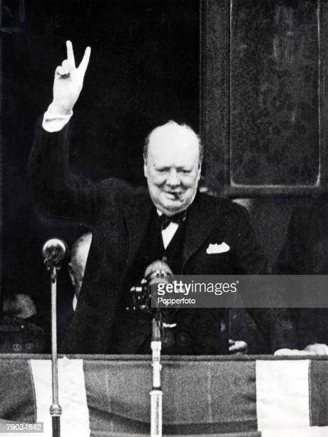 8th May1945 World War Two VE Day celebrations in London British Prime Minister Winston Churchill gives his famous victory sign from the balcony of...