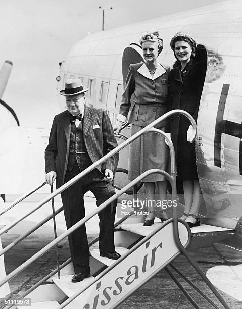 British Prime Minister Winston Churchill his wife Clementine and their daughter Mary boarding a Swissair plane at Biggin Hilll taking them on holiday...