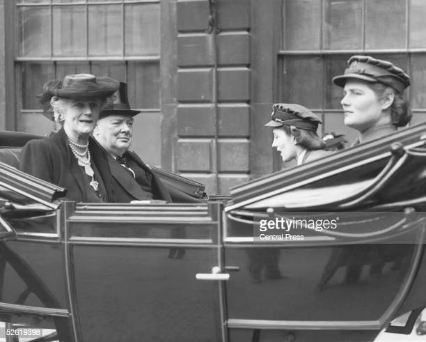 British Prime Minister Winston Churchill in an open carriage on his way to the City of London where he is to be presented with the Freedom of the...