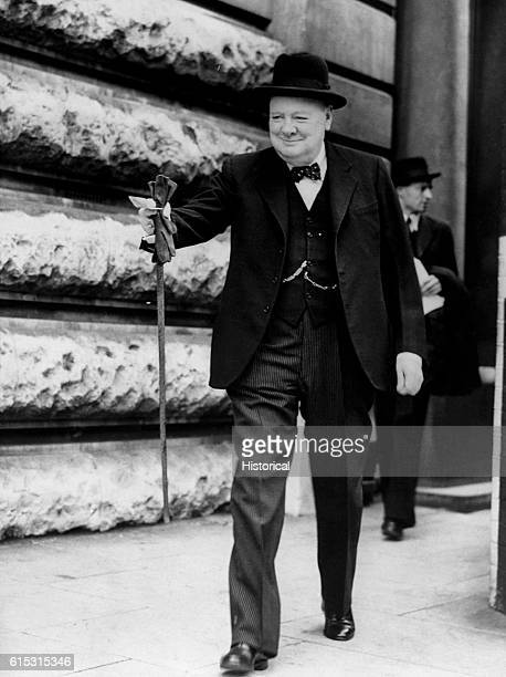 British Prime Minister Winston Churchill leaves the Number Ten Annexe in London on the morning of DDay 6th June 1944 on his way to Parliament to...