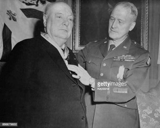 British Prime Minister Winston Churchill receives the hereditary membership of the Society of the Cincinnati from US MajorGeneral Edgar Erskine Hume...