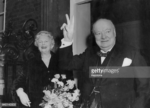 British Prime Minister Winston Churchill returns to 10 Downing Street in London with his wife Clementine after his 80th birthday celebrations in...