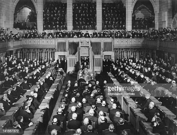 British Prime Minister Winston Churchill speaking to members of the Senate and House of the Canadian Parliament gathered in a Joint Session. Ottawa,...