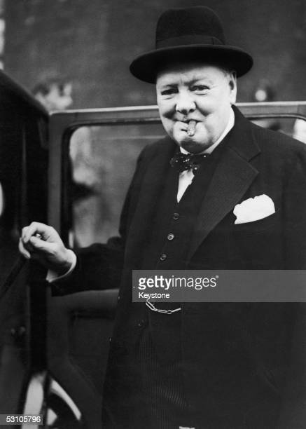 British Prime Minister Winston Churchill steps into his car at the rear of Downing Street on his way to hand in his resignation to King George VI...