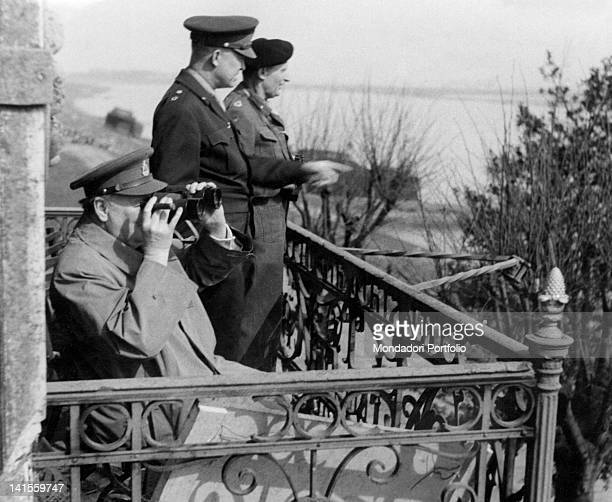 British Prime Minister Winston Churchill US General Dwight David Eisenhower and British Marshal Bernard Law Montgomery watching the crossing of the...