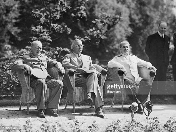 British Prime Minister Winston Churchill US President Harry S Truman and Soviet Premier Joseph Stalin sit together at the Potsdam Conference in 1945
