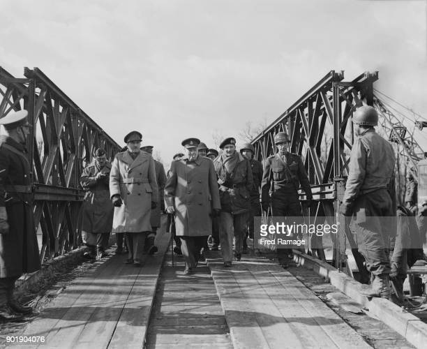 British Prime Minister Winston Churchill walks over the bailey bridge near Jülich in Germany during a visit to the Western Front World War II March...
