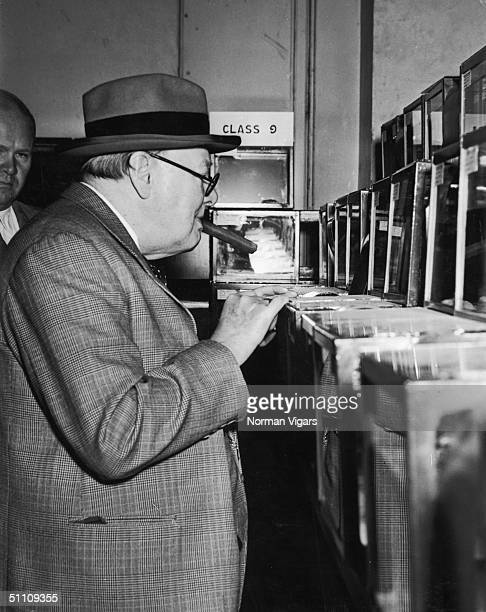 British prime minister Winston Churchill watches some Siamese fighting fish at the 5th National Aquarium Exhibition at the Royal Horticultural Hall,...