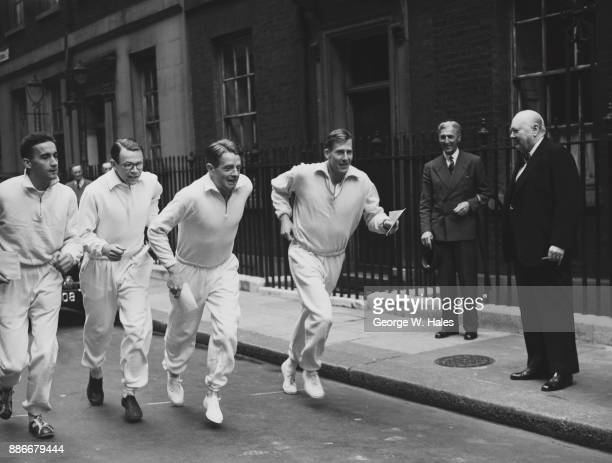 British Prime Minister Winston Churchill watches the first relay of runners each carrying a cheque for £500 set off as part of the Save Our Churches...