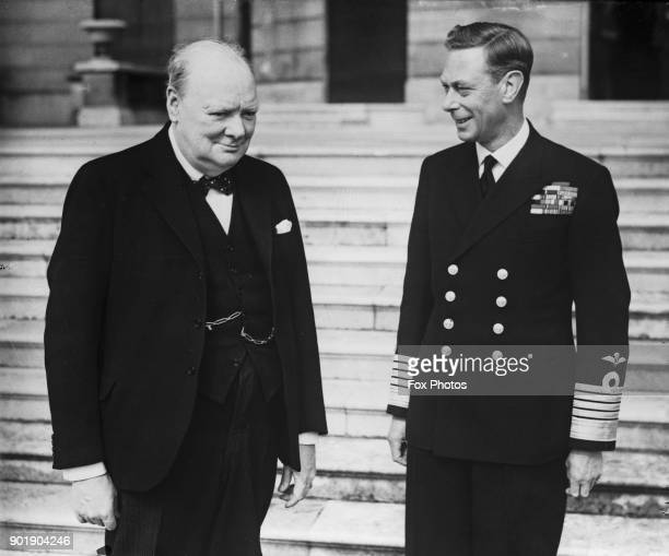 British Prime Minister Winston Churchill with King George VI in the grounds of Buckingham Palace London during World War II circa 1942