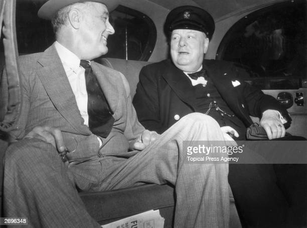 British Prime Minister Winston Leonard Spencer Churchill with Franklin Delano Roosevelt 32nd President of the United States seated in a car on their...