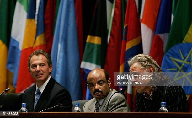 British Prime Ministers Tony Blair with Ethiopian counterpart Meles Zenawi look over as Sir Bob Geldof addresses the audience at concluding meeting...