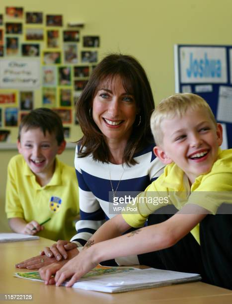 British Prime Minister's wife Samantha Cameron talks to Joshua Westcott and Joshua Jones during a tour of Baston House School in Bromley Kent before...