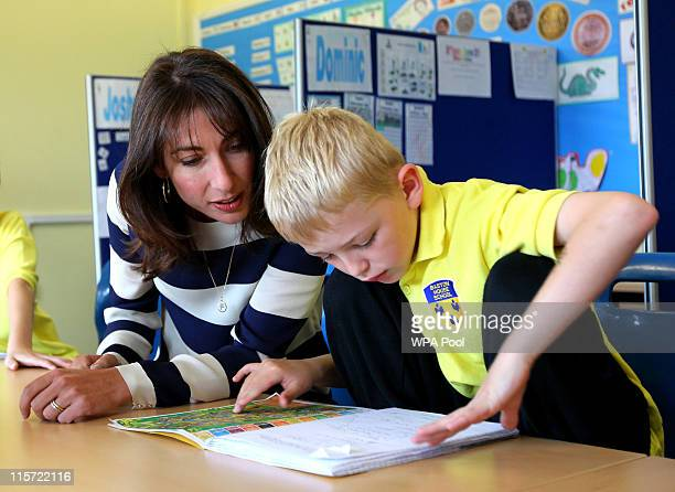 British Prime Minister's wife Samantha Cameron talks to Joshua Westcott during a tour of Baston House School in Bromley Kent before she officially...