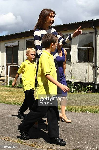 British Prime Minister's wife Samantha Cameron walks with Joshua Jones and Joshua Westcott 8 during a tour of Baston House School in Bromley Kent...