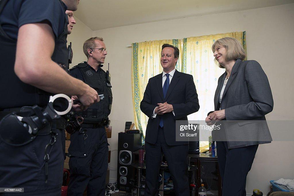 Prime Minister David Cameron and Home Secretary Theresa May Visit Slough : News Photo