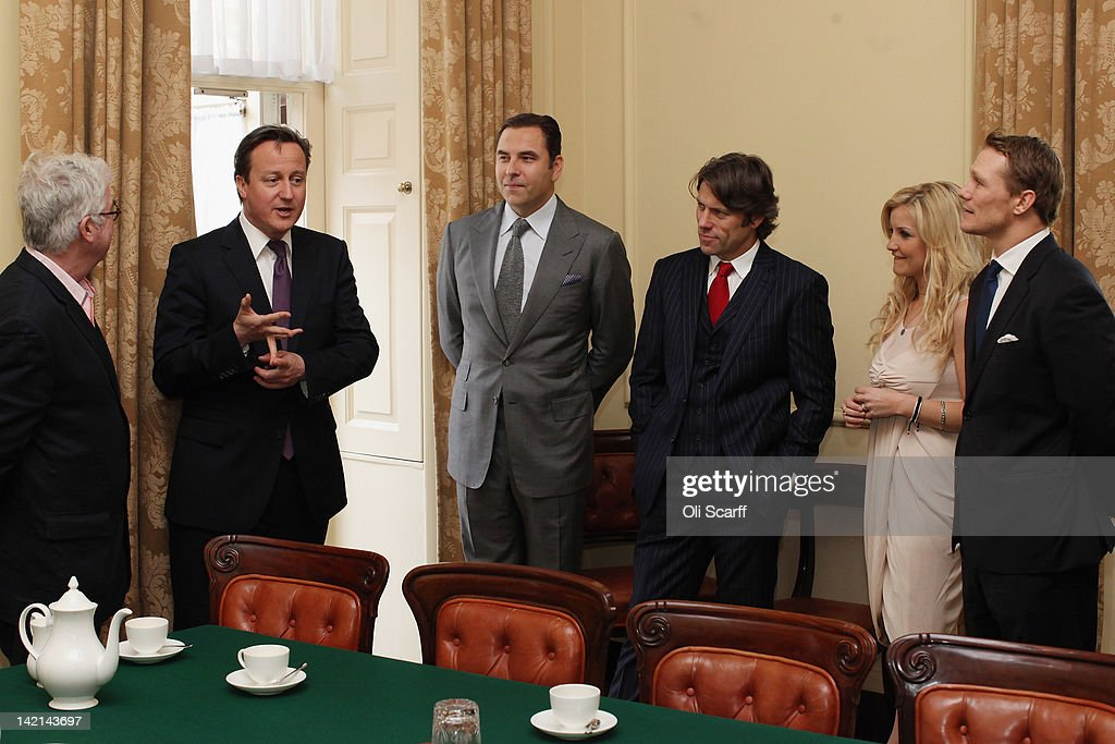 British Prime Minster David Cameron (2nd L) meets with former England Rugby Union player Josh Lewsey (R), TV presenter Helen Skelton (2nd R) and comedians John Bishop (3rd R) and David Walliams (3rd L) inside Number 10 Downing Street on March 30, 2012 in London, England. The four celebrities met with British Prime Minister David Cameron to discuss their individual efforts to raise money for the Sport Relief.