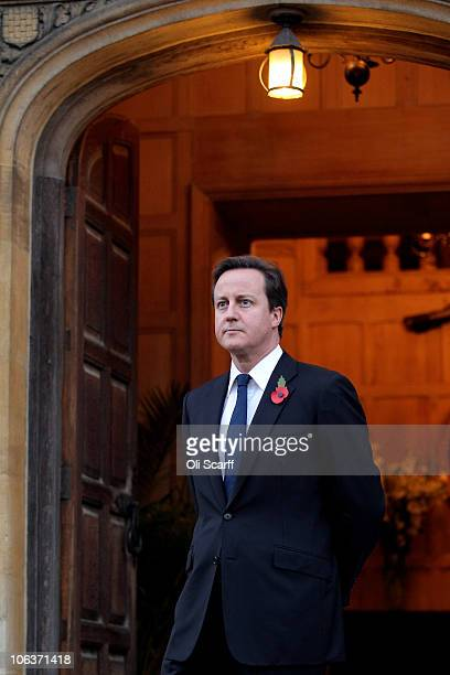 British Prime Minster David Cameron waits to greet the German Chancellor Angela Merkel outside Chequers the Prime Minister's country residence on...
