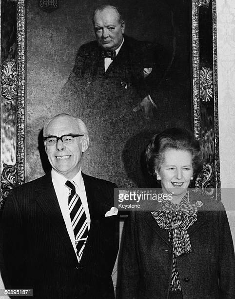 British Prime Minster Margaret Thatcher and her husband Denis Thatcher standing in front of a portrait of Winston Churchill celebrating her 10 years...