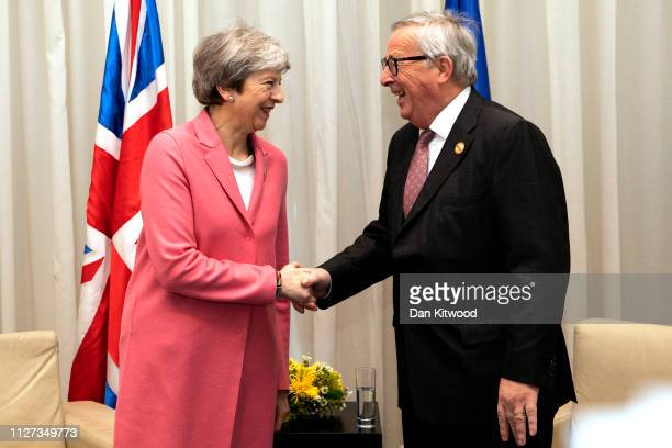 British Prime Minster Theresa May and President of European Commission JeanClaude Juncker shake hands during bilateral talks at the first...