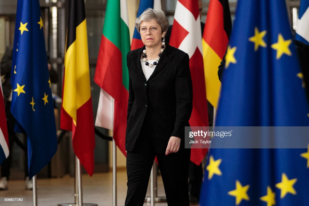 British Prime Minster Theresa May arrives at the Council of the European Union on the final day of the European Council leaders' summit on March 23, 2018 in Brussels, Belgium. European Union leaders meet today for the two-day European Council. The agenda includes discussion on the recent nerve agent attack in Salisbury, which the UK holds the Russian state responsible, and US President Donald Trump's announcement on tariffs for steel and aluminium imports. The proposed Brexit transition deal between the European Union and the United Kingdom is also expected to be approved.