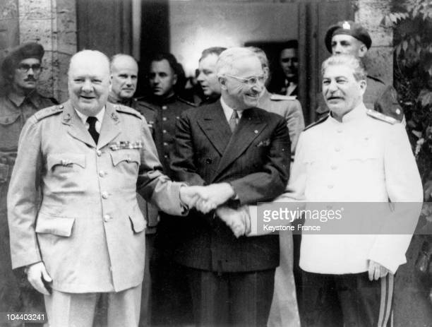 British Prime Minster Winston CHURCHILL, United States President Harry TRUMAN and General STALIN shaking hands and smiling during the Potsdam...