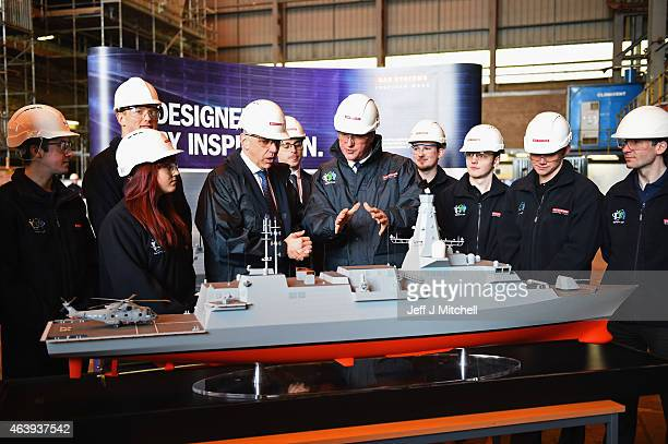 British Prime Prime Minister David Cameron looks at a model of The T26 Global Combat Ship as he visits the BAE Systems shipyard on February 20 2015...